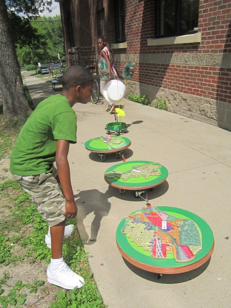 Youth from a Redeemer Lutheran Church summer camp take the Caterpillar for a walk. Artist Diane Willow asked the youth for their opinions on the proposed Southwest Light Rail Transit station just blocks from Redeemer Lutheran Church in the Harrison neighborhood.